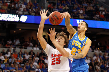 TAMPA, FL - MARCH 19:  Tyler Honeycutt #23 of the UCLA Bruins blocks a shot attempt by Chandler Parsons #25 of the Florida Gators during the third round of the 2011 NCAA men's basketball tournament at St. Pete Times Forum on March 19, 2011 in Tampa, Flori