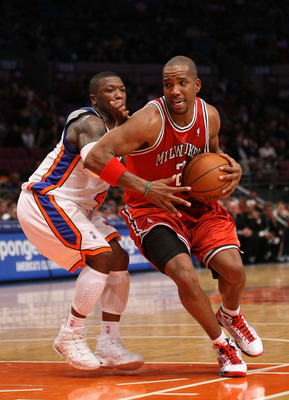 NEW YORK - DECEMBER 19: Michael Redd #22 of the Milwaukee Bucks drives to the basket against Nate Robinson #4 of the New York Knicks on December 19, 2008 at Madison Square Garden in New York City, New York. NOTE TO USER: User expressly acknowledges and ag