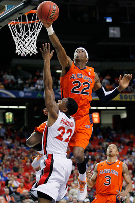 ATLANTA, GA - MARCH 10:  Kenny Gabriel #22 of the Auburn Tigers blocks a shot by Gerald Robinson #22 of the Georgia Bulldogs during the the first round of the SEC Men's Basketball Tournament at the Georgia Dome on March 10, 2011 in Atlanta, Georgia.  (Pho