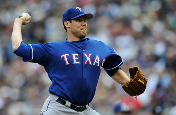 MINNEAPOLIS, MN - JUNE 11: Colby Lewis #48 of the Texas Rangers pitches against the Minnesota Twins during the first inning of their game on June 11, 2011 at Target Field in Minneapolis, Minnesota. (Photo by Hannah Foslien/Getty Images)
