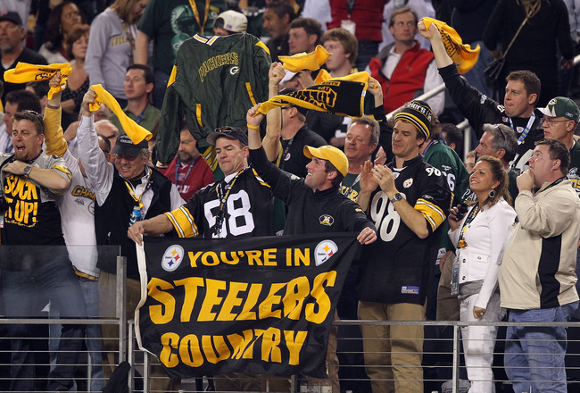 ARLINGTON, TX - FEBRUARY 06: Steelers fans celebrate in the crowd during Super Bowl XLV against the Green Bay Packers at Cowboys Stadium on February 6, 2011 in Arlington, Texas.  (Photo by Al Bello/Getty Images)