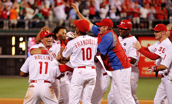 PHILADELPHIA - JUNE 15:  Carlos Ruiz #51 of the Philadelphia Phillies is mobbed by his teammates following a walk off wining hit to give the Phillies a 5-4 win in the bottom of the 10th against the Florida Marlins during game two of a day night double hea