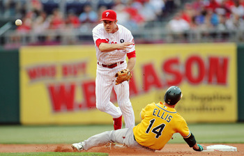 PHILADELPHIA - JUNE 25:  Chase Utley #26 of the Philadelphia Phillies avoids a take out slide by Mark Ellis #14 of the Oakland Athletics at Citizens Bank Park on June 25, 2011 in Philadelphia, Pennsylvania. The Athletics defeated the Phillies 4-1.  (Photo