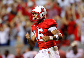 RALEIGH, NC - OCTOBER 16:  Quarterback Russell Wilson #16 of the North Carolina State Wolfpack celebrates after a touchdown against the Florida State Seminoles during the game at Carter-Finley Stadium on September 16, 2008 in Raleigh, North Carolina.  (Ph