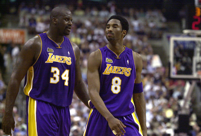 15 Jun 2001:  Shaquille O''Neal #34 and Kobe Bryant #8 of the Los Angeles Lakers walk to the bench during a time-out in game five of the NBA Finals against the Philadelphia 76ers at the First Union Center in Philadelphia, Pennsylvania.  The Lakers won 108