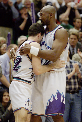 21 Apr 2001:  Karl Malone #32 gives John Stockton #12 of the Utah Jazz a hug after they escaped with an 88-86 win over the Dallas Mavericks during their first round playoff game at the Delta Center in Salt Lake City, Utah.  <DIGITAL IMAGE> Mandatory Credi