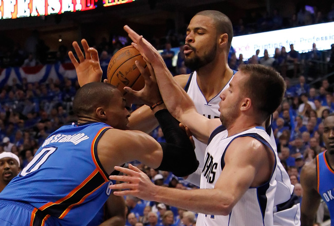 DALLAS, TX - MAY 19:  Russell Westbrook #0 of the Oklahoma City Thunder goes up for a shot against both Tyson Chandler #6 and Jose Juan Barea #11 of the Dallas Mavericks in the second quarter in Game Two of the Western Conference Finals during the 2011 NB