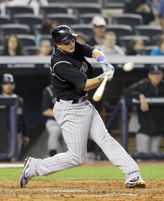 NEW YORK, NY - JUNE 24: Troy Tulowitzki # 2 of the Colorado Rockies connects on a fifth inning home run against the New York Yankees on June 24, 2011 at Yankee Stadium in the Bronx borough of New York City.  (Photo by Jim McIsaac/Getty Images)