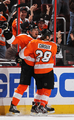 PHILADELPHIA - MARCH 05: James van Riemsdyk #21 of The Philadelphia Flyers celebrates his goal with Claude Giroux #28 against the Buffalo Sabresduring their game on March 5, 2011 at The Wells Fargo Center in Philadelphia, Pennsylvania.  (Photo by Al Bello