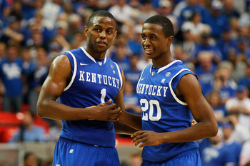 ATLANTA, GA - MARCH 13:  Darius Miller #1 and Doron Lamb #20 of the Kentucky Wildcats celebrate during their 70 to 54 win over the Florida Gators in the championship game of the SEC Men's Basketball Tournament at Georgia Dome on March 13, 2011 in Atlanta,
