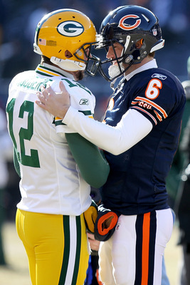 CHICAGO, IL - JANUARY 23:  Quarterback Aaron Rodgers #12 of the Green Bay Packers and quarterback Jay Cutler #6 of the Chicago Bears shake hands before the NFC Championship Game at Soldier Field on January 23, 2011 in Chicago, Illinois.  (Photo by Doug Pe