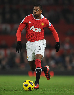 MANCHESTER, ENGLAND - NOVEMBER 20:  Patrice Evra of Manchester United plays the ball during the Barclays Premier League match between Manchester United and Wigan Athletic at Old Trafford on November 20, 2010 in Manchester, England.  (Photo by Michael Rega