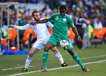 BLOEMFONTEIN, SOUTH AFRICA - JUNE 17: Taye Taiwo of Nigeria holds off Dimitrios Salpingidis of Greece during the 2010 FIFA World Cup South Africa Group B match between Greece and Nigeria at the Free State Stadium on June 17, 2010 in Mangaung/Bloemfontein,
