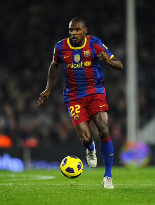 BARCELONA, SPAIN - NOVEMBER 13:  Eric Abidal of Barcelona runs with the ball during the La Liga match between Barcelona and Villarreal CF at Camp Nou Stadium on November 13, 2010 in Barcelona, Spain. Barcelona won the match 3-1.  (Photo by David Ramos/Get