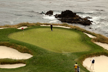 PEBBLE BEACH, CA - JUNE 18:  Steve Marino hits a bunker shot on the seventh hole during the second round of the 110th U.S. Open at Pebble Beach Golf Links on June 18, 2010 in Pebble Beach, California.  (Photo by Ross Kinnaird/Getty Images)