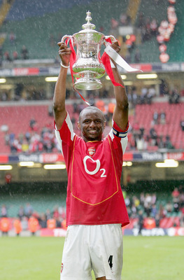 CARDIFF, UNITED KINGDOM - MAY 21:  Captain, Patrick Vieira of Arsenal holds aloft the trophy after winning the FA Cup Final between Arsenal and Manchester United 5-4 on penalty's at The Millennium Stadium on May 21, 2005 in Cardiff, Wales.  (Photo by Ross