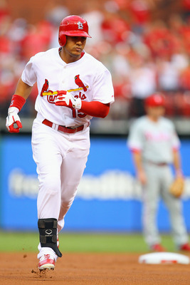 ST. LOUIS, MO - JUNE 23: Jon Jay #15 of the St. Louis Cardinals rounds the bases after hitting a home run against the Philadelphia Phillies at Busch Stadium on June 23, 2011 in St. Louis, Missouri.  (Photo by Dilip Vishwanat/Getty Images)