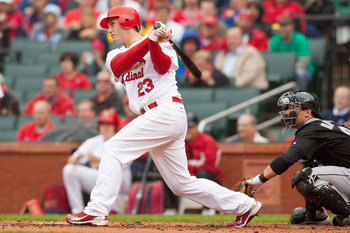 ST. LOUIS - MAY 20: David Freese #23 of the St. Louis Cardinals hits an RBI single against the Florida Marlins at Busch Stadium on May 20, 2010 in St. Louis, Missouri.  The Cardinals beat the Marlins 4-2.  (Photo by Dilip Vishwanat/Getty Images)