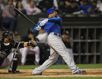 CHICAGO, IL - JUNE 22: Carlos Pena #22 of the Chicago Cubs hits a solo home run in the 6th inning against the Chicago White Sox at U.S. Cellular Field on June 22, 2011 in Chicago, Illinois. The White Sox defeated the Cubs 4-3. (Photo by Jonathan Daniel/Ge
