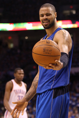 OKLAHOMA CITY, OK - MAY 21:  Tyson Chandler #6 of the Dallas Mavericks looks at the ball in the third quarter while taking on the Oklahoma City Thunder in Game Three of the Western Conference Finals during the 2011 NBA Playoffs at Oklahoma City Arena on M