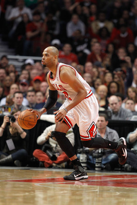 CHICAGO, IL - MAY 15:  Taj Gibson #22 of the Chicago Bulls brings the ball up court against the Miami Heat in Game One of the Eastern Conference Finals during the 2011 NBA Playoffs on May 15, 2011 at the United Center in Chicago, Illinois. The Bulls won 1