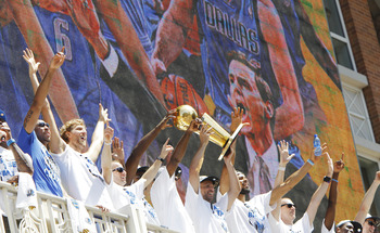 DALLAS, TX - JUNE 16: Guard Jason Kidd of the Dallas Mavericks hoists the Larry O'Brien Trophy with his teammates during the Dallas Mavericks Victory Parade on June 16, 2011 in Dallas, Texas. (Photo by Brandon Wade/Getty Images)