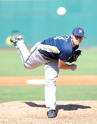 GOODYEAR, AZ - MARCH 11:  Mark Rogers #64 of the Milwaukee Brewers pitches during a Spring Training game against the Cincinnati Reds on March 11, 2010 at Goodyear Ballpark in Goodyear, Arizona.  (Photo by Lisa Blumenfeld/Getty Images)