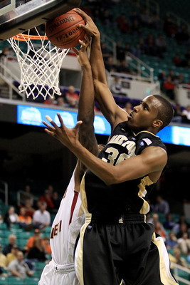 GREENSBORO, NC - MARCH 10:  Travis McKie #30 of the Wake Forest Demon Deacons shoots against the Boston College Eagles during the second half of the game in the first round of the 2011 ACC men's basketball tournament at the Greensboro Coliseum on March 10