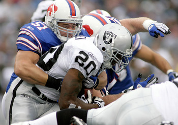 ORCHARD PARK, NY - SEPTEMBER 21: Paul Posluszny #51 of the Buffalo Bills tackles Darren McFadden #20 of the Oakland Raiders on September 21, 2008 at Ralph Wilson Stadium in Orchard Park, New York.  Buffalo won 24-23. (Photo by Rick Stewart/Getty Images)