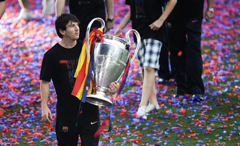 BARCELONA, SPAIN - MAY 29:  Lionel Messi of FC Barcelona holds the UEFA Champions League Trophy during the celebrations after winning the UEFA Champions League Final against Manchester United at Camp Nou Stadium on May 29, 2011 in Barcelona, Spain.  (Phot