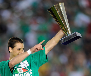 PASADENA, CA - JUNE 25:  Javier 'Chicharito' Hernandez #14 of Mexico holds the Most Valuable Player award trophy after defeating  the United States in the 2011 CONCACAF Gold Cup Championship at the Rose Bowl on June 25, 2011 in Pasadena, California.  (Pho