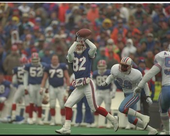 3 Jan 1993: Wide receiver Don Beebe of the Buffalo Bills catches the ball during a playoff game against the Houston Oilers at Rich Stadium in Orchard Park, New York. The Bills won the game in overtime, 41-38.