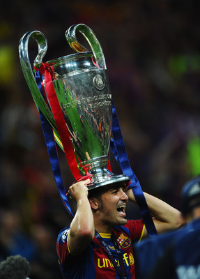 LONDON, ENGLAND - MAY 28:  David Villa of FC Barcelona wears the trophy on his head after victory in UEFA Champions League final between FC Barcelona and Manchester United FC at Wembley Stadium on May 28, 2011 in London, England.  (Photo by Laurence Griff