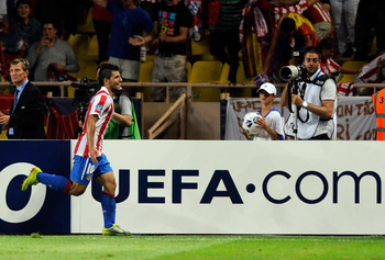 MONACO - AUGUST 27:  Sergio Aguero celebrates after the second goal during the UEFA Super Cup between Inter and Atletico Madrid at Louis II Stadium on August 27, 2010 in Monaco, Monaco.  (Photo by Claudio Villa/Getty Images)
