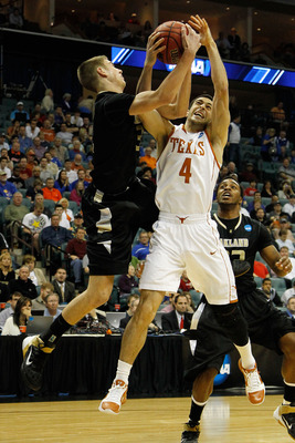 TULSA, OK - MARCH 18:  Dogus Balbay #4 of the Texas Longhorns fights for a rebound with Travis Bader #3 of the Oakland Golden Grizzlies during the second round of the 2011 NCAA men's basketball tournament at BOK Center on March 18, 2011 in Tulsa, Oklahoma