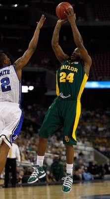 HOUSTON - MARCH 28: LaceDarius Dunn #24 of the Baylor Bears puts up a shot over Nolan Smith #2 of the Duke Blue Devils during the south regional final of the 2010 NCAA men's basketball tournament at Reliant Stadium on March 28, 2010 in Houston, Texas. Duk