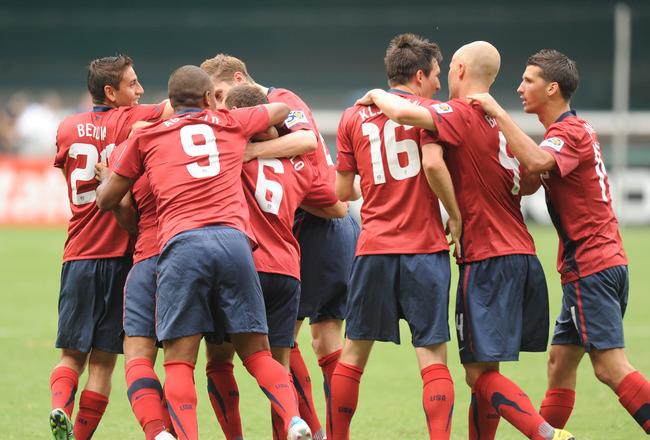WASHINGTON, DC - JUNE 19:   Players of the United States celebrate their first goal in the second half against Jamaica during the 2011 Gold Cup Quarterfinals on June 19, 2011 at RFK Stadium in Washington, D.C.  The United States won 2-0.  (Photo by Mitche
