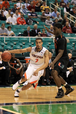 GREENSBORO, NC - MARCH 10:  Mustapha Farrakhan #2 of the Virginia Cavaliers drives against Adrian Thomas #30 of the Miami Hurricanes during the first round of the 2011 ACC men's basketball tournament at the Greensboro Coliseum on March 10, 2011 in Greensb