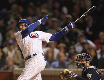 CHICAGO, IL - JUNE 14: Aramis Ramirez #16 of the Chicago Cubs hits a game-tying, two-run home run in the 8th inning against the Milwaukee Brewers at Wrigley Field on June 14, 2011 in Chicago, Illinois. (Photo by Jonathan Daniel/Getty Images)