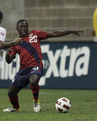 HOUSTON - JUNE 22:  Freddy Adu #20 of the U.S.A. attempts to control the ball as he his defended by Gabriel Gomez #6 of Panama in the second half at Reliant Stadium on June 22, 2011 in Houston, Texas.  (Photo by Bob Levey/Getty Images)