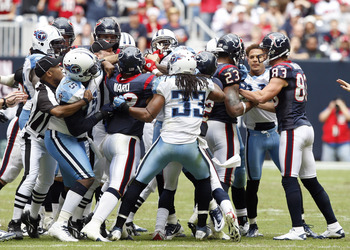 HOUSTON - NOVEMBER 28:  Officials attempt to separate players from both the Houston Texans and Tennessee Titans after a bench emptying brawl in the fourth quarter that was started by Andre Johnson of the Houston Texans and Cortland Finnegan of the Tenness