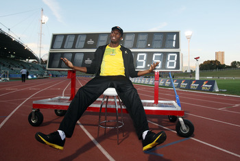 SYDNEY, AUSTRALIA - SEPTEMBER 15:  Usain Bolt poses in front of a scoreboard showing his world record time of 9.58 seconds during the Athletic Allstars Meet at Sydney Olympic Park Athletic Centre on September 15, 2010 in Sydney, Australia.  (Photo by Mark