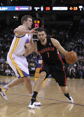 OAKLAND, CA - MARCH 25: Andrea Bargnani #7 of the Toronto Raptors drives on David Lee #10 of the Golden State Warriors at Oracle Arena on March 25, 2011 in Oakland, California. NOTE TO USER: User expressly acknowledges and agrees that, by downloading and
