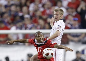 DETROIT, MI - JUNE 7: Tim Ream #15 of the United States battles for the ball with Simeon Jackson #17 of Canada during the 2011 Gold Cup  at Ford Field on June 7, 2011 in Detroit, Michigan. The United States won the game 2-0. (Photo by Gregory Shamus/Getty