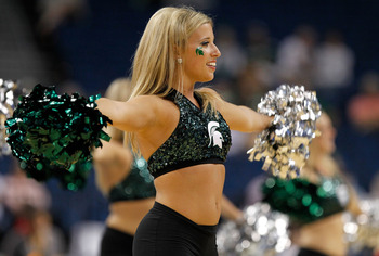 TAMPA, FL - MARCH 17:  A cheerleader from the Michigan State Spartans performs against the UCLA Bruins during the second round of the 2011 NCAA men's basketball tournament at St. Pete Times Forum on March 17, 2011 in Tampa, Florida.  (Photo by J. Meric/Ge