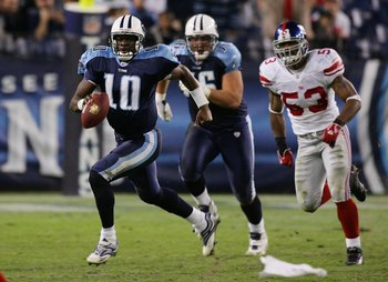 NASHVILLE, TN - NOVEMBER 26:  Vince Young #10 of the Tennessee Titans runs the ball in the fourth quarter against the New York Giants during their game on November 26, 2006 at LP Field in Nashville, Tennessee.  (Photo by Jim McIsaac/Getty Images)