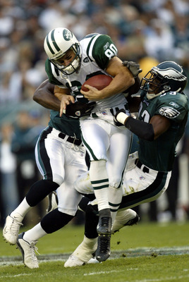 PHILADELPHIA - OCTOBER 26:  Wayne Chrebet #80 of the New York Jets is tackled by Clinton Hart #33 of the Philadelphia Eagles October 26, 2003 at the Lincoln Financial Field Stadium in Philadelphia, Pennsylvania. The Eagles defeated the Jets 24-17.  (Photo