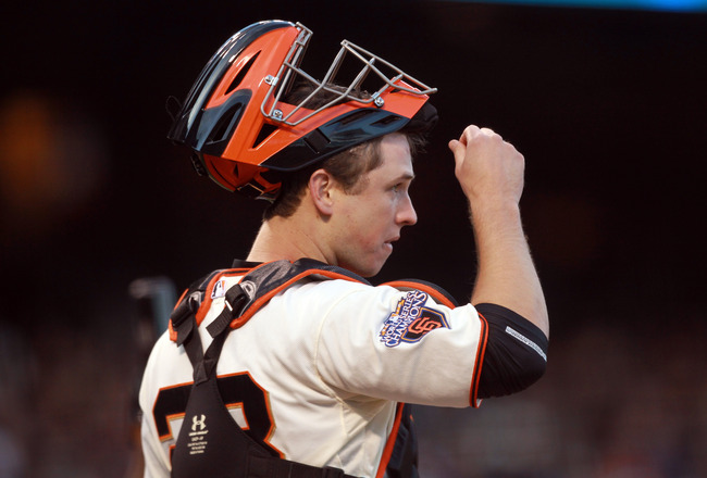 SAN FRANCISCO, CA - MAY 24:  Buster Posey #28 of the San Francisco Giants gets ready to catch against the Florida Marlins at AT&T Park on May 24, 2011 in San Francisco, California.  (Photo by Ezra Shaw/Getty Images)