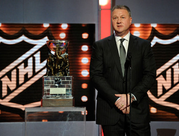 LAS VEGAS, NV - JUNE 22:  General Manager Mike Gillis of the Vancouver Canucks accepts the NHL General Manager of the Year Award during the 2011 NHL Awards at The Pearl concert theater at the Palms Casino Resort June 22, 2011 in Las Vegas, Nevada.  (Photo