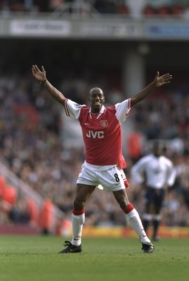 13 Sep 1997:  Ian Wright of Arsenal raises his arms in celebration after he scores during an FA Carling Premiership match against Bolton Wanderers at Highbury Stadium in London. Arsenal won the match 4-1. \ Mandatory Credit: Shaun  Botterill/Allsport